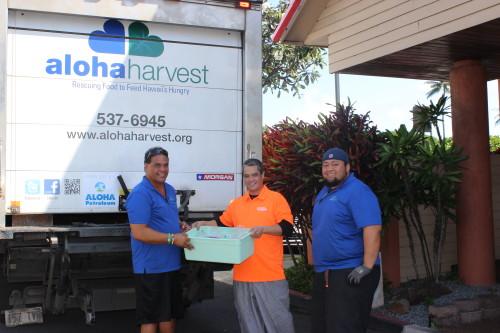 Pictured: Hiram Johnson (Aloha Harvest) with Jace Wong (Outback Steakhouse) and Michael Lelafu (Aloha Harvest)