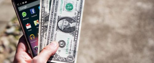 mobile-phone-money-banknotes-us-dollars-163069-1100x450